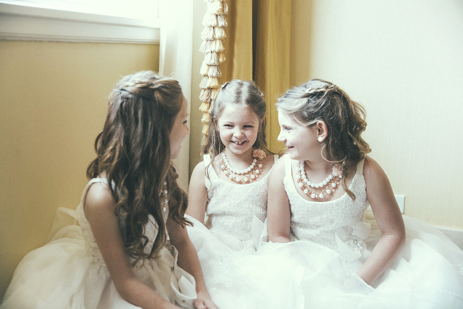 These cute flower girls were chatting it up before the ceremony! New Orleans Wedding at Southern Oaks Plantation, Featured in Southern Bride.