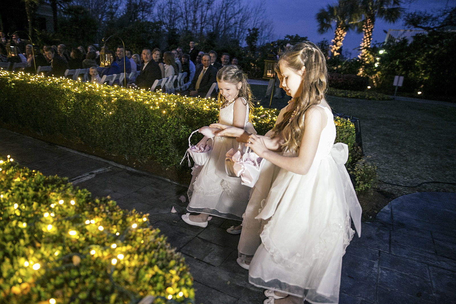 New Orleans Wedding at Southern Oaks Plantation, Featured in Southern Bride. The Flower girls as they make their way down the lit up aisle.