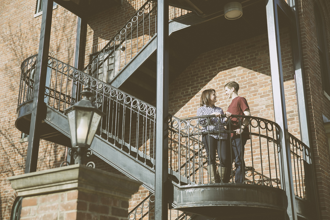 Downtown Lexington Kentucky Engagement Photography. This one in particular was done at the Opera house, the iron railing is so beautiful for photos.