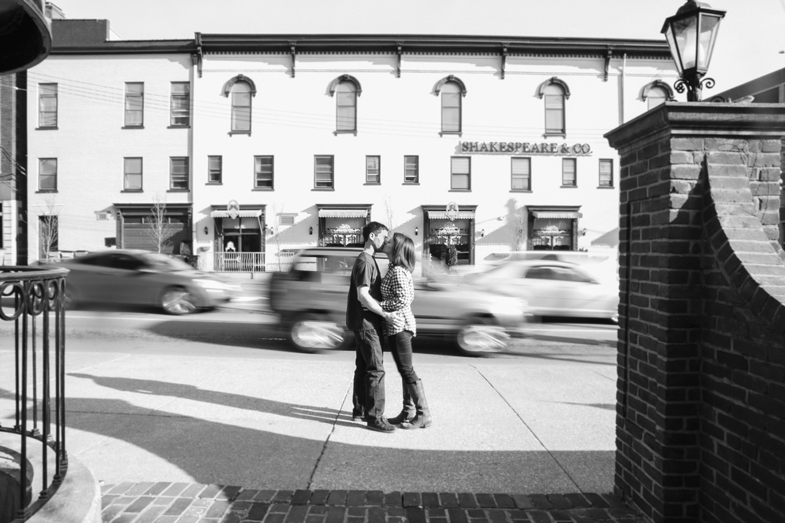 Lexington Kentucky Engagement Session Downtown. Love the rushing cars as they blur in the background. shows that love can stop a moment in time.